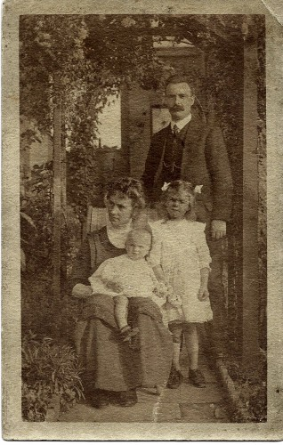 About 1912 with her parents (my grandparents) and her older sister, Olive