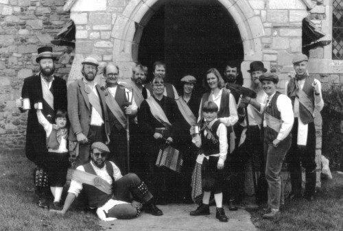 "The Mirkmere Morris photographed in front of the porch of St. Fenella's church, we believe sometime in the early post-war period. This is the only photograph we have of the ""old"" side before the dances were remembered by the revival side."